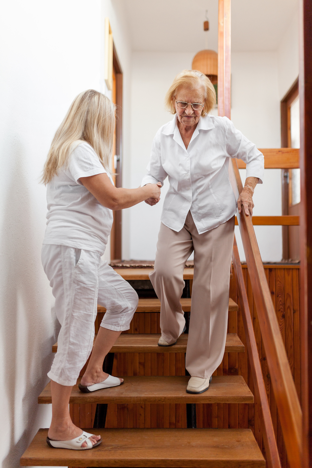 woman walking downstairs with help